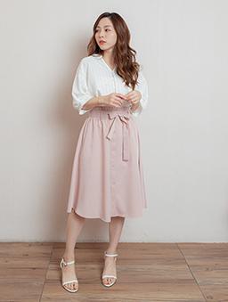 氣質女伶腰鬆緊附綁帶假排釦中長裙-粉色